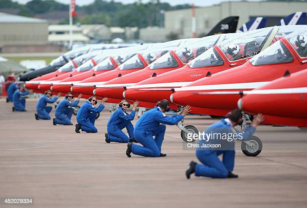 The RAF Red Arrows Display team prepare to leave their stand at the Royal International Air Tattoo at RAF Fairford on July 11, 2014 in Fairford,...