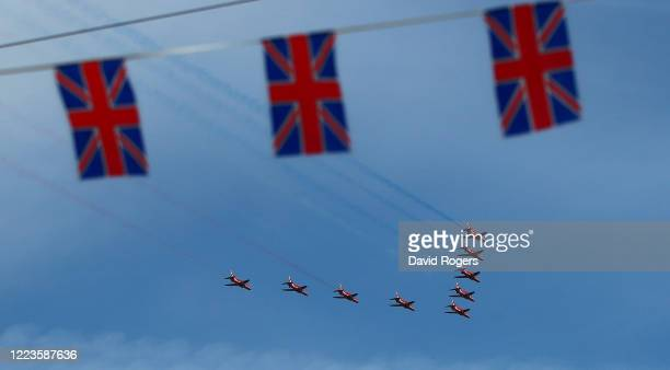 The RAF Red Arrows fly over Northampton on May 08 2020 in Northampton United KingdomThe UK commemorates the 75th Anniversary of Victory in Europe Day...