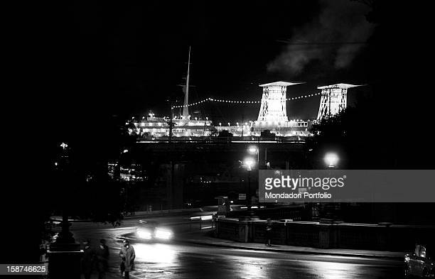 The Raffaello transatlantic liner lighted for the night and ready to sail to New York Genoa December 1965