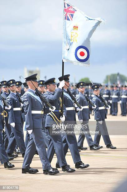 The RAF's new colours are held high during a march past at RAF Fairford on July 11, 2008 in Gloucestershire, England.