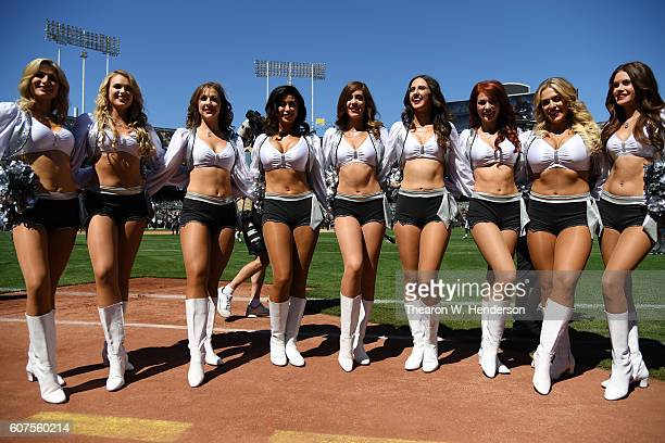 The Raiderettes pose for a photo prior to the NFL game between the Oakland Raiders and the Atlanta Falcons at OaklandAlameda County Coliseum on...