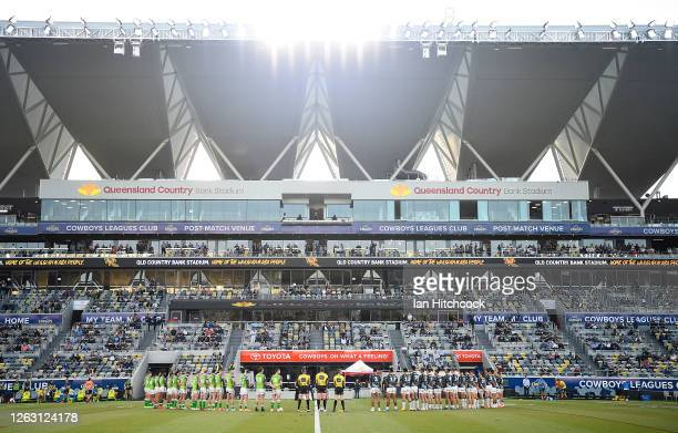 The Raiders and Cowboys stand together on the field before the start of the round 12 NRL match between the North Queensland Cowboys and the Canberra...