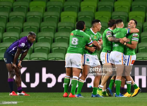The Raiders celebrate a try during the round three NRL match between the Melbourne Storm and the Canberra Raiders at AAMI Park on May 30, 2020 in...