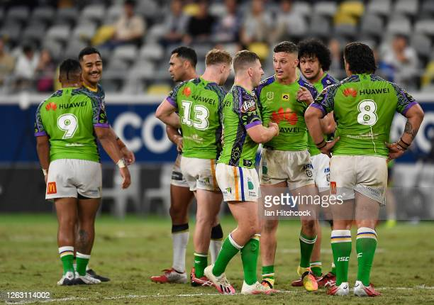 The Raiders celebrate after winning the round 12 NRL match between the North Queensland Cowboys and the Canberra Raiders at QCB Stadium on August 01...