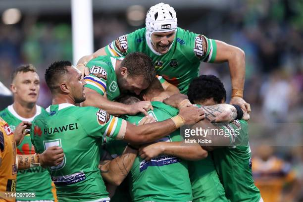 The Raiders celebrate with John Bateman of the Raiders after he scored a try during the round 6 NRL match between the Canberra Raiders and the...