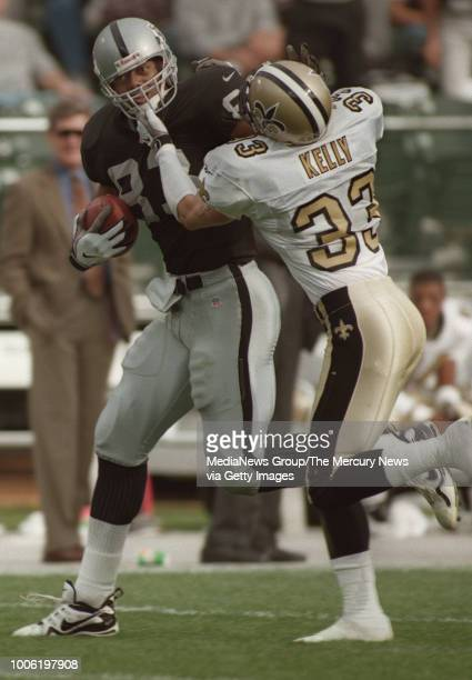 The Raiders' Rickey Dudley gets wrapped up by the Saints Rob Kelly in the 2nd quarter