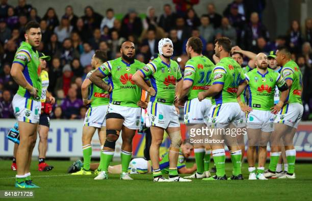 The Raiders stand behind their line after the Storm scored a try during the round 26 NRL match between the Melbourne Storm and the Canberra Raiders...
