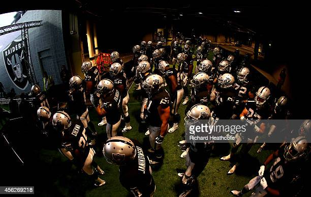 The Raiders take to the field prior to kickoff during the NFL match between the Oakland Raiders and the Miami Dolphins at Wembley Stadium on...