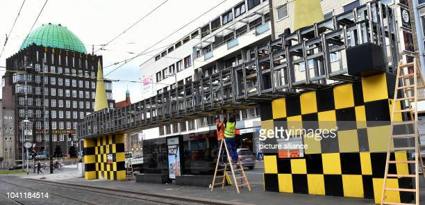 The rail stop put up by Alessandro Mendini for the Hanover City Rail in the course of the BUSSTOPS art project being dismantled in downtown Hanover...