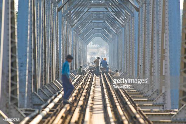 the railway bridge on yamuna river, mathura, india - built structure stock pictures, royalty-free photos & images