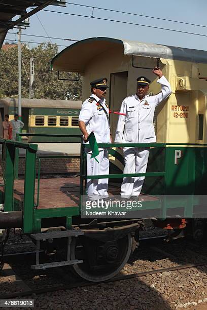 The Railway guard and his assistant in his cabin waving the green flag. Few years before The Last steam safari was arranged from Lahore Cant Station...