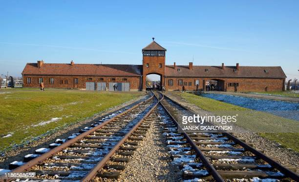 The railway tracks entering the main building at the Auschwitz-Birkenau German Nazi death camp are pictured ahead of German Chancellor Angela...