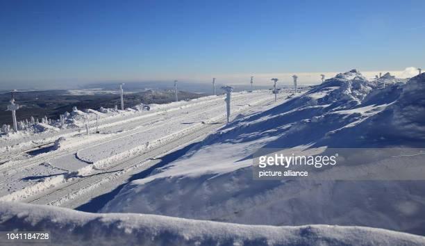 The railway tracks of Harzer Schmalspurbahnen GmbH on Brocken mountain in Wernigerode Germany 18 January 2016 The approximately 140kilometrelong...