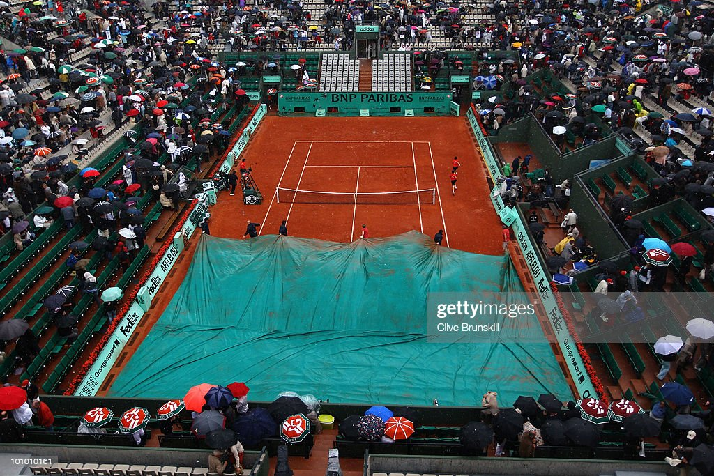 The rain covers come on during the men's singles second round match between Andy Roddick of the United States and Blaz Kavcic of Slovenia at the French Open on day five of the French Open at Roland Garros on May 27, 2010 in Paris, France.