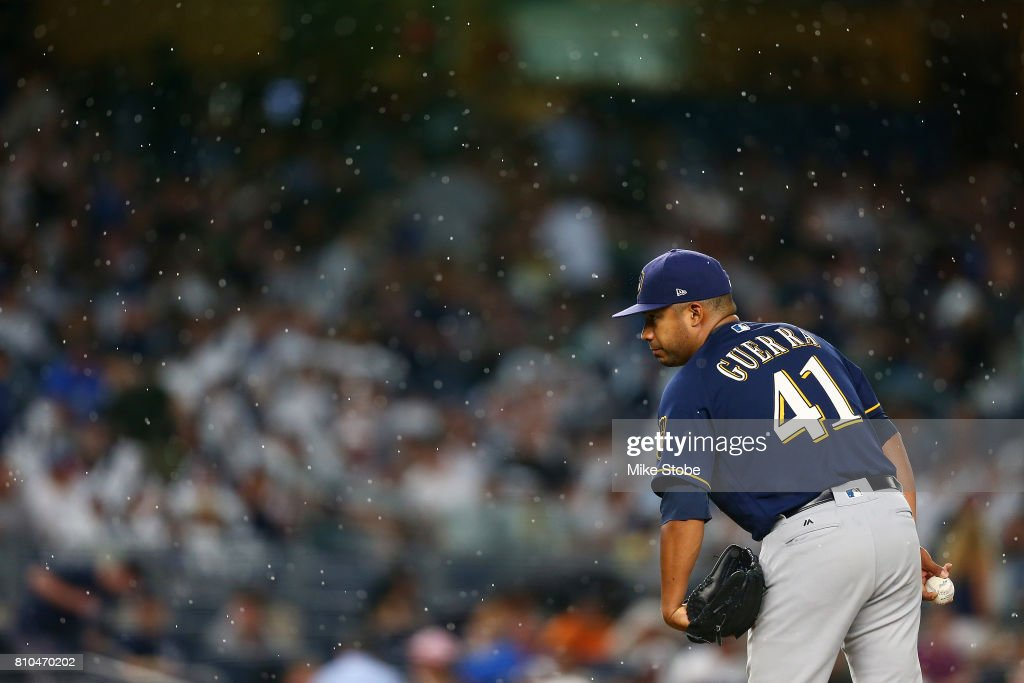 The rain falls as Junior Guerra #41 of the Milwaukee Brewers get set to pitch in th efourth inning against the New York Yankees at Yankee Stadium on July 7, 2017 in the Bronx borough of New York City.