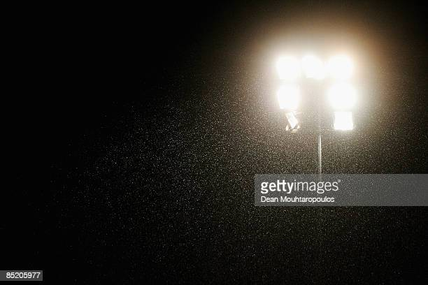 The rain falls in front of the floodlight during the Coca-Cola Football League Two match between Dagenham Redbridge and Exeter at Victoria Road...