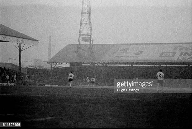 The rain is torrential during a crucial away game for Chelsea at Bolton's Burnden Park
