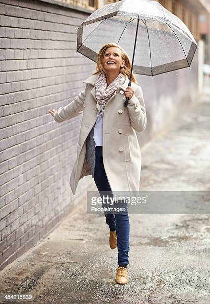 the rain makes me feel free! - skipping along stock photos and pictures