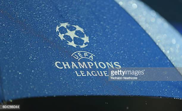 The rain pours onto an umbrella prior to the UEFA Champions League Group A match between Manchester City FC and VfL Borussia Moenchengladbach at...