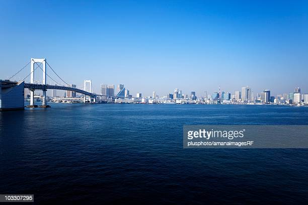 the rainbow bridge and tokyo city during the day. minato ward, tokyo prefecture, japan - plusphoto stock pictures, royalty-free photos & images