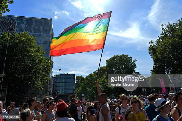 The rainbow flag blows in the sun as thousands of people gather to support gay rights by celebrating during the Gay Pride Parade on June 27 2015 in...