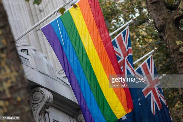 The rainbow flag hangs in front of Australian flags outside Australia House on November 16 2017 in London England Australia voted yesterday to...