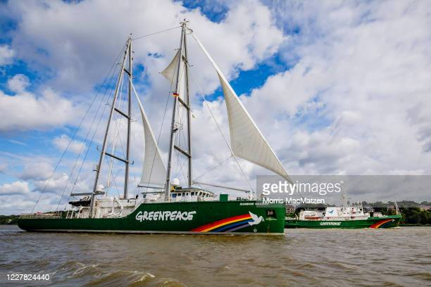 The Rainbow Warrior and Esperanza , ships of the environmental activist group Greenpeace, arrive in Hamburg Port on July 29, 2020 in Hamburg,...