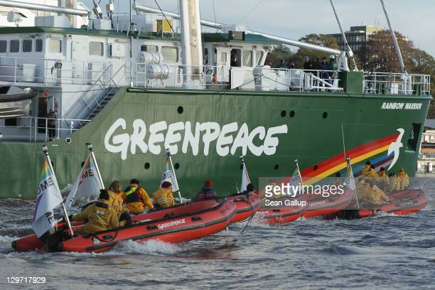 The Rainbow Warrior III the newest ship of the enivornmental conservation organization Greenpeaceis accompanied by Greenpeave activists in rubber...