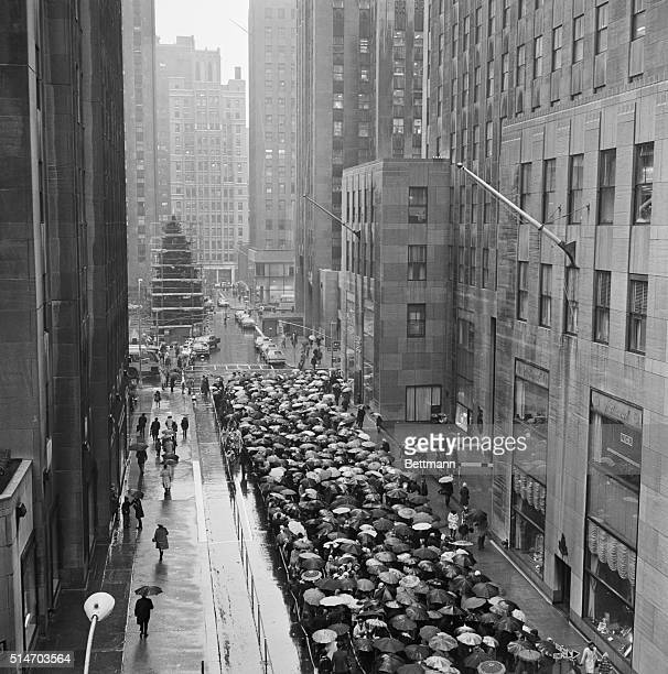 The rains came and so did the crowds lined up completely around the block to see the Radio City Music Hall's Great Christmas show A Boy Named Charlie...
