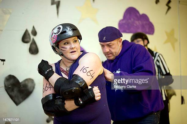 The Rainy City Rollar Girls coach numbers a player before the Rollergirls Roller Derby event on April 14 2012 in Oldham England The contact sport of...