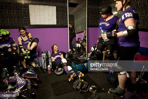 The Rainy City Rollar Girls have a team meeting at half time of the Rollergirls Roller Derby event on April 14, 2012 in Oldham, England. The contact...