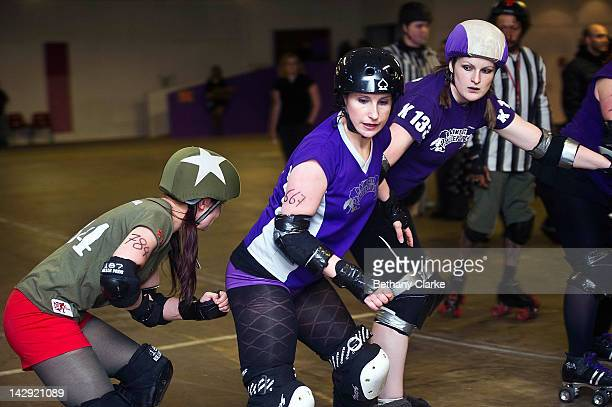 The Rainy City Rollergirls compete with the Birmingham Blitz Dames during a Rollergirls Roller Derby event in Oldham April 14 2012 in Oldham England...
