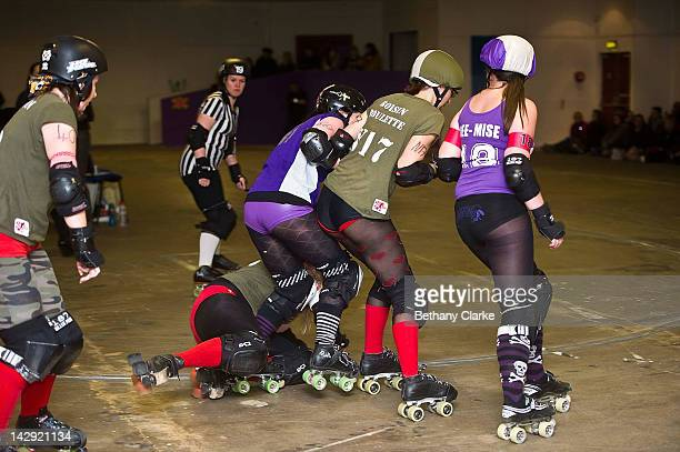 The Rainy City Rollergirls compete with the Birmingham Blitz Dames during a Rollergirls Roller Derby event on April 14 2012 in Oldham England The...