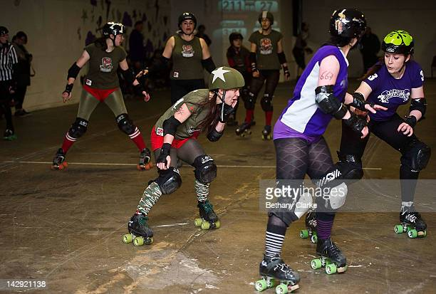 The Rainy City Rollergirls compete with the Birmingham Blitz Dames during a Rollergirls Roller Derby event on April 14, 2012 in Oldham, England. The...