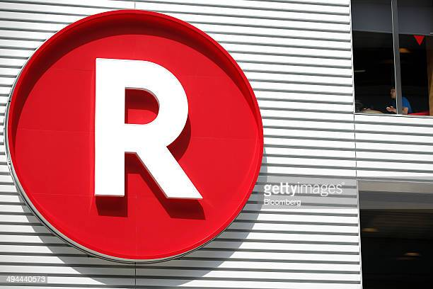 The Rakuten Inc logo is displayed outside the company's Rakuten Cafe in Tokyo Japan on Thursday May 29 2014 Japan's retail sales dropped at the...