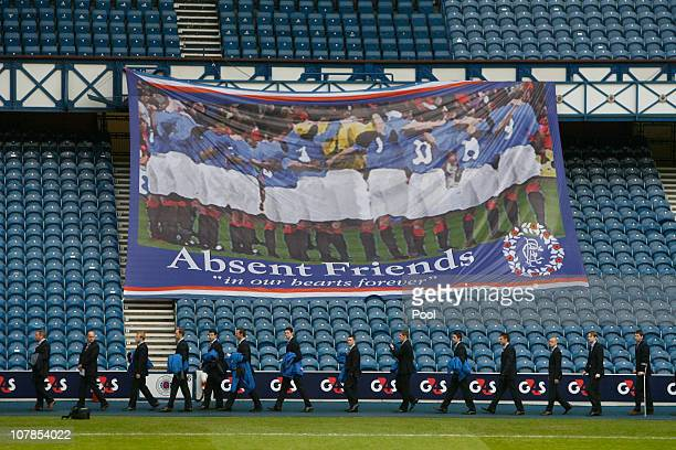 The Rangers directors and dignatories enter the stadium for the service to commemorate the 40th Anniversary Memorial of the Ibrox Disaster held at...