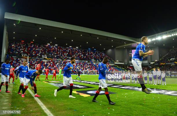 The Rangers FC team walk out prior to the UEFA Europa League round of 16 first leg match between Rangers FC and Bayer 04 Leverkusen at Ibrox Stadium...