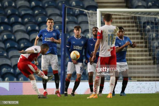 The Rangers wall attempt to block a free kick taken by Nicolae Stanciu of Slavia Praha who scores their side's second goal during the UEFA Europa...