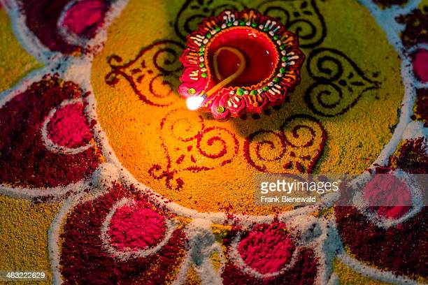 The Rangoli an artwork made from colored powder and an oil lamp to welcome the festival Diwali