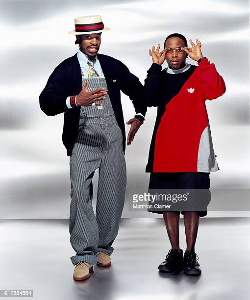 The rap band OutKast Dre wearing overalls and a hat with Big Boi