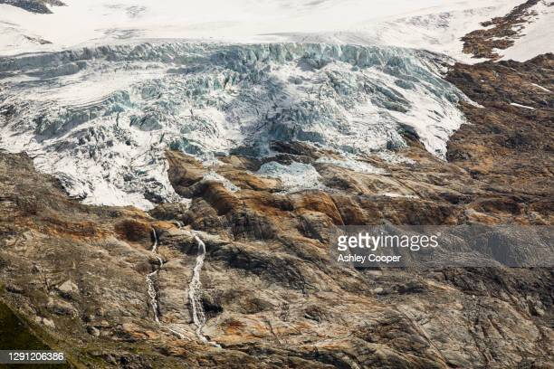 the rapidly retreating glacier du tour, above tour in the chamonix valley, french alps. - retreating ストックフォトと画像