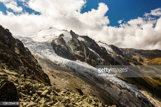 the rapidly retreating glacier du trient in the swiss alps. - retreating ストックフォトと画像