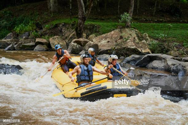 the rapids are vivacious but they enjoy the challenge - rafting stock pictures, royalty-free photos & images