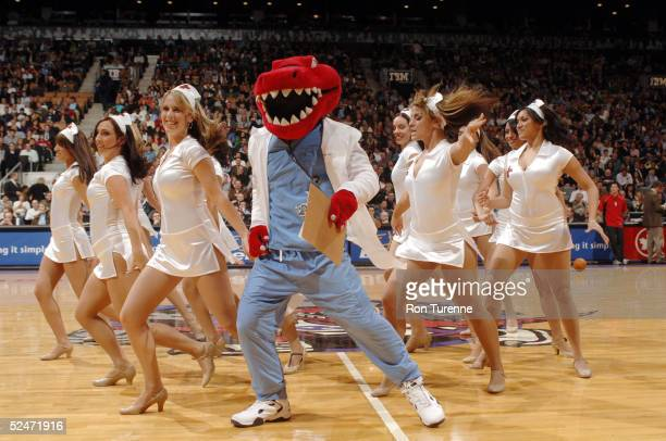The Raptor and the Raptors Dance Pak demonstrate the advantages to universal health care during the Toronto Raptors game against the Chicago Bulls on...