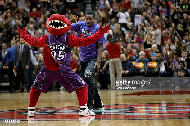 TORONTO MARCH 13 The Raptor mascot has his head on backwards as he watches the males of the dance crew Toronto Raptors vs Miami Heat in 2nd half...