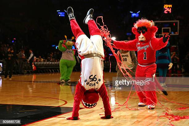 The Raptor mascot of the Toronto Raptors and Benny the Bull of the Chicago Bulls perform on court during the BBVA Compass Rising Stars Challenge 2016...