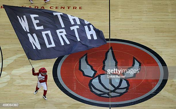 TORONTO ON OCTOBER 29 The Raptor waves a flag before tipoff as the Toronto Raptors open the 201415 season against the Atlanta Hawks at Air Canada...