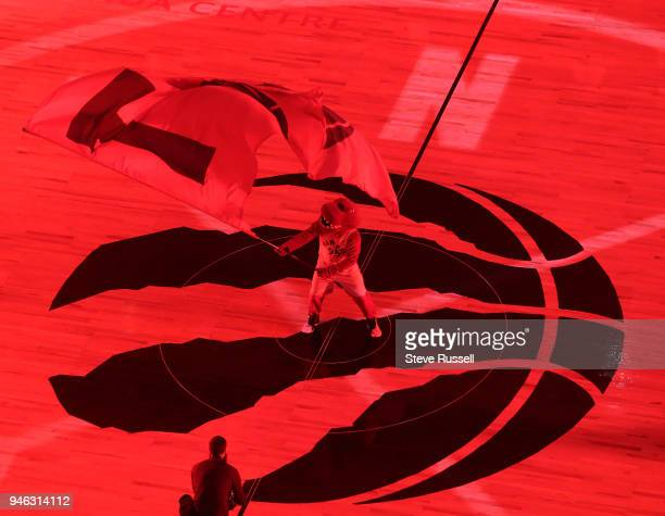 TORONTO ON APRIL 14 The Raptor waves the flag during introductions as the Toronto Raptors open the first round of the NBA playoffs aginst the...