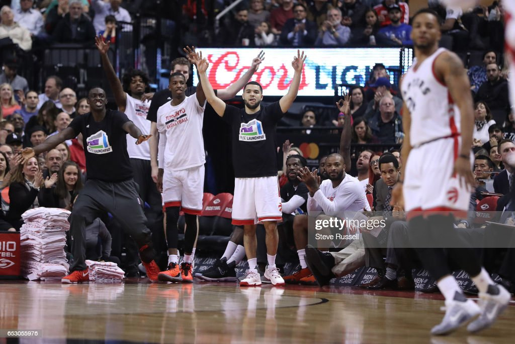 TORONTO, ON- MARCH 13 - The Raptors bench celebrates a Norman Powell three pointer as the Toronto Raptors beat the Dallas Mavericks 100-78 at the Air Canada Centre in Toronto. March 13, 2017.
