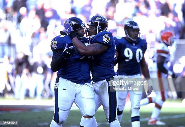 The Ravens Defense celebrate after a great play Left Defensive Tackle Sam Adams and MiddleLine Backer Ray Lewis of the Baltimore Ravens bump heads...